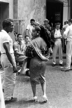 Photograph by Peter Stackpole. Havana, Cuba, March 1959. Her figure.