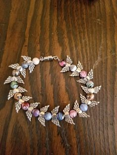 Multi colored marble beads with a heart wing beads to separate with. Magnetic clasp