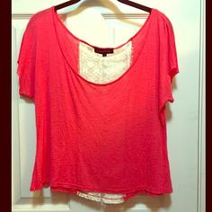 Pink Top Lacey back on this top. Really pretty pink color. Only worn this top twice. Doesn't go much with any other clothing I own. Is a small but fits like a size medium. Tops