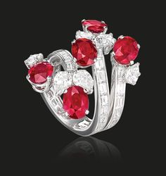 Ruby and Diamond Ring | Rubies and diamonds gracefully made to wrap around in an elegant ring.  Rubies 7.19 cts Diamonds 5.98 cts  #houseoftabbah #tabbah