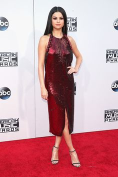 Selena Gomez in a Givenchy dress with Jimmy Choo shoes and Tacori earrings.  Don't like it from the sides, but Selena is smoking from the front in this ruby red Givenchy dress. Selena has been giving us full on bombshell since 2013, but, like Demi, this look seems to pull from a more mature place. Combined with her simple make-up and long, bone straight hair, the effect is quite striking.
