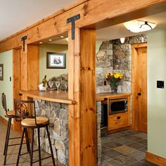 Love the wood and stone in this basement bar/kitchen  My jaw just dropped