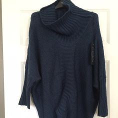 NWT boutique navy poncho/sweater Never worn sweater. Super cute to layer over pencil skirt and boots Sweaters