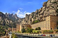 Montserrat Monastery, Spain. Tucked against a mountain it is incredible to think that anyone could build something so grandiose in such a high place. But they did and it's definitely worth seeing. And don't miss the Black Madonna; she alone is worth the trip.