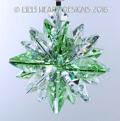 Swarovski Crystal Peridot Green and Clear Super Star Suncatcher Car Charm Window Prism https://www.etsy.com/listing/271183046/mw-swarovski-crystal-clear-and-peridot