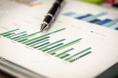 Financial graphs and pen royalty-free stock photo