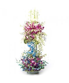 Mother's day flower gift...  A Lovely Arrangement of 50 purple & blue Orchids with lots of fillers & greens.  price: Rs.3,499.00  Visit BookUrGift for more gift ideas.