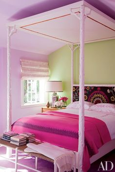 In a Beverly Hills, California, home decorated by Peter Dunham Design, the hand-carved canopy bed in the pink bedroom is by Hollywood at Home. See more blush, coral, magenta, and raspberry rooms for Valentine's Day now.