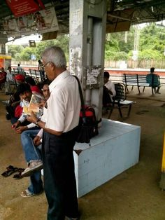 Sharing The Good News of God's Kingdom at a train stop in India  ~ JW.org