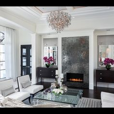 Black and white. Mirrors. Glass. Modern fireplace. Shine. By Merilee Bentz Designs.