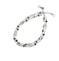 "-ARIES- ""Dual layers of silver and charcoal grey beads mix with clear, faceted beads on this double-strand piece that's a sophisticated necklace, bracelet or layered with Gemini or Lyra as a belt or necklace."" http://LMAWBY.mialisia.com"
