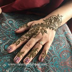A beautifully decorated hand is worth a thousand kisses.  For more ideas see Henna party design