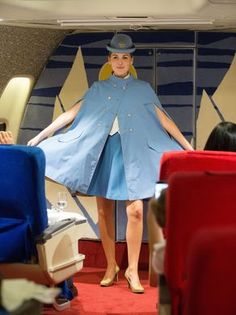 Stewardess Emma Rose participates in the vintage uniform
