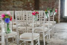 Image by Gather & Tides Photography - Mussenden Temple wedding venue in Northern Ireland with a Tara Keely bridal gown and bright peony bouquet by Gather and Tides Photography.