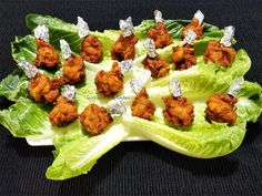 """An elegant finger food made with chicken wings using the technique called """"frenching"""". The meat is detached from the smaller end of the drummette and pushed all the way up to create an appearance of a lollipop. Healthy Chicken, Fried Chicken, Tandoori Chicken, Chicken Appetizers, Chicken Recipes, Chicken Tikka, Chicken Wings, Lollipop Recipe, Chicken Lollipops"""