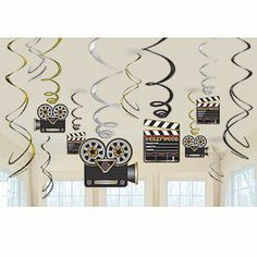 Our Lights Camera Action Swirls Value Pack feature Hollywood clapboards, old fashioned movie cameras and black, silver and gold foil swirls.