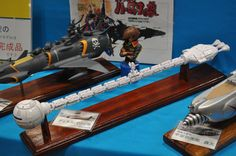 Captain Harlock's Arcadia pulls up alongside the Discovery from 2001.  Models at Wonderfest Japan, 2015.