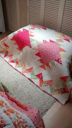 Traditional quilt with kantha-style quilting.