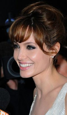 Angelina Jolie updo with bangs