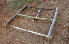 Here's how to hack out your own bucksaw frame from just a few straight sticks, using your knife, two nails, and some 550 paracord.