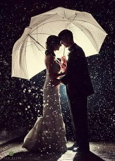 **Love artistic photos like this. Love the lighting from behind, the silhouettes of the bride and groom, and the snow (if we are lucky!!)