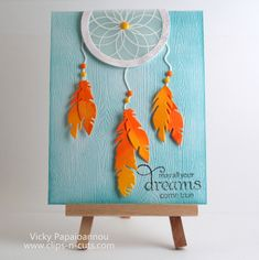 handcrafted greeting card from STAMPtember® blog hop ... dreamcatcher with die cut feathers hanging down ... great contrast between the aqua embossed wood grain background and the orange/yellow colored feathers ... perfect sentiment too ...