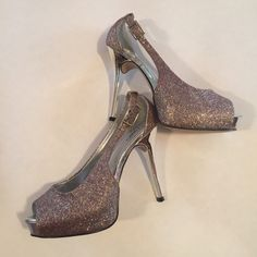 Size 7 dressy sparkly heels Worn one time  when the light hits them they sparkle different colors blues pink gold silver awesome heels Cato Shoes Heels