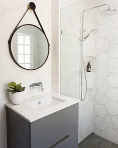 I was watching one of those American reno shows last night and the girl was using dark grout with her white honeycomb shaped tiles and they came up amazing. I tossed up about the dark grout in my own kitchen. Hexagon Tile Bathroom, Bathroom Tile Designs, Bathroom Renos, Bathroom Interior, Modern Bathroom, Small Bathroom, Master Bathroom, Hex Tile, Bathroom Ideas
