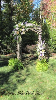 A spectacular early autumn wooden arch lavishly decorated with gorgeous gladiolus and antique hydrangea.