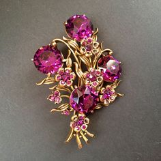 Beautiful Vintage Brooch - Signed Hollycraft 1954 Amethyst Rhinestone (several of the smallest stones are missing) Gold-tone setting Approx 2 x 2 3/4 in This item will be wrapped in tissue and shipped