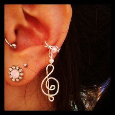 Hey, I found this really awesome Etsy listing at http://www.etsy.com/listing/104706136/ear-cuff-hanging-music-note