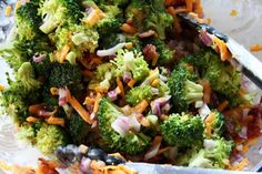 Bacon Cheddar Broccoli Salad~  Recipe doubles well for a large crowd!  Ingredients:  For the Dressing:  1 cup mayonnaise  1/2 cup sugar  2 tablespoons vinegar    For the Broccoli Salad:  1 stalk of broccoli, cut into bite-sized pieces  1/2 pound of bacon, cooked crispy and chopped  4 ounces cheddar cheese, shredded  1/2 small red onion, finely diced