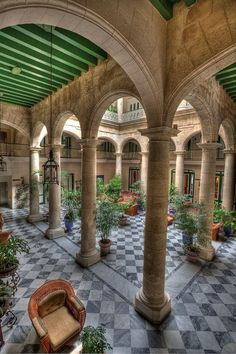Marble floors and intricately designed archways leading to Spanish-styled inner courtyards. Havana, Cuba
