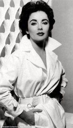 Elizabeth Taylor in a trench coat. Timeless...