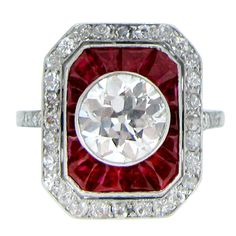 Antique Ruby Diamond Cluster Ring c1911 | From a unique collection of vintage engagement rings at http://www.1stdibs.com/jewelry/rings/engagement-rings/