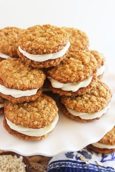 Oatmeal Buttercream Pies – Easy to make and irresistibly good, these super-soft vanilla oatmeal cookies are amazing with a fluffy buttercream filling!