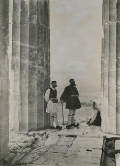 «Le tourisme en Grèce», Boissonnas 1928. Two men stand on the Parthenon while a woman sits against a column.  1900s. Location: Parthenon, Acropolis, Athens, Greece. Photographer: FRED BOISSONNAS/National Geographic Creative