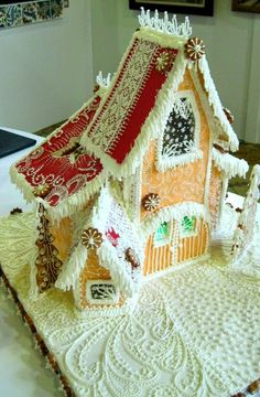 Gingerbread house - Love the snow piping on the edge of the roof and pretty designs on the ground.