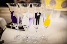 Wedding theme: Lovebirds  Wedding colours: purple & yellow    Decal stickers on the champagne glasses that match with the clothes of the groom, the bride and the bridesmaids