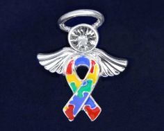 """Autism Awareness Pin - Angel Tac (Retail) by Fundraising For A Cause. $10.00. This Autism Angel Pin is a BIG seller!! Absolutely adorable! Doesn't everyone want an Angel looking over them? Wear a ribbon - a symbol to share of hope, strength, and courage to show all that you care. This pin is 1"""" long by 3/4"""" wide. The body of the angel is multi colored puzzle pieces with angel wings and halo. This pin is approx 1 inch by 3/4 inch. Each autism ribbon pin comes in a box with cotton ..."""