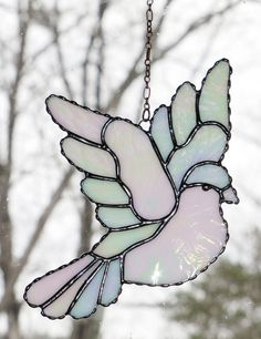 Stained Glass Suncatcher Iridescent White Dove Peace by GLASSbits- another stained glass creation that helps us remember peace.in our thoughts, words, and actions! Stained Glass Birds, Stained Glass Christmas, Stained Glass Suncatchers, Faux Stained Glass, Stained Glass Designs, Stained Glass Panels, Stained Glass Projects, Stained Glass Patterns, Leaded Glass