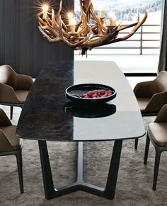 Dining table with emperador marble top and walnut base tables