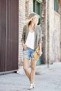 Shop this look for $94:  http://lookastic.com/women/looks/military-jacket-and-tank-and-gladiator-sandals-and-shorts-and-clutch/2262  — Olive Military Jacket  — White Tank  — White Leather Gladiator Sandals  — Light Blue Denim Shorts  — Mustard Leather Clutch