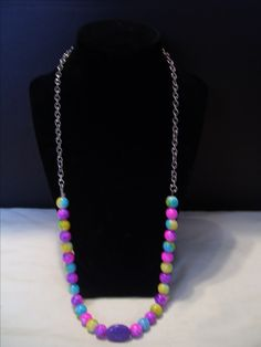 """This is a colorful 20"""" string and chain necklace.  Beads are 8mm and center is oval glass bead.  I am honored to have set up with the Alzheimers Organization an agreement that I will contribute 10% of all sales to them in honor of my late father."""