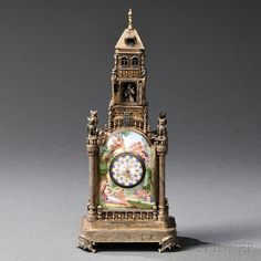 Viennese Silver and Enamel Tower-form Clock, Austria, late 19th century, enamel panel sides with owl-topped columns and circular clock.