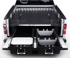 Maximize your truck's practicality by keeping all your belongings stashed away within this truck bed organizer. Once installed, you'll have two bed-length drawers and four ammo cans at your disposal so that all your gear remains neatly arranged.