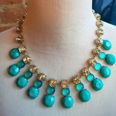 """✨BANANA REPUBLIC Statement Necklace Stunning Banana Republic Turquoise Colored and Sparkly Statement Necklace. Middle strand of turquoise-colored beads are glass. 20"""" end to end. A bit over 1.5""""H measuring from the top of the clear sparkly gem to the bottom of the turquoise colored gem. ✨ Only until I was closely examining the necklace did I see an interior crack in the last glass bead. Unnoticeable by touch. Only noticeable when looking for it. Banana Republic Jewelry Necklaces"""