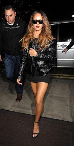 Rihanna london fashion week 2013 black dress strappy heels sunglasses leather jacket paparazzi february