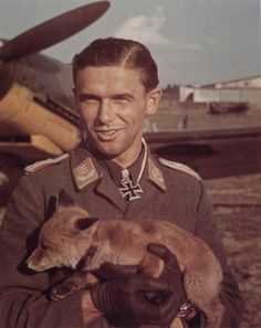 Luftwaffe ace Lieutenant Colonel Hans Philipp with fox mascot. He claimed 206 downed enemy aircraft in over 500 sorties. He was killed in action 8 October, 1943.