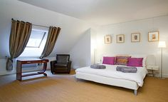 The master bedroom can accommodate two guests in a very comfortable queen size bed. It is decorated with carpeting and is getting extra light through a Velux® window. The master bedroom is connected to its ensuite bathroom (tub, marble basin, bidet and WC).